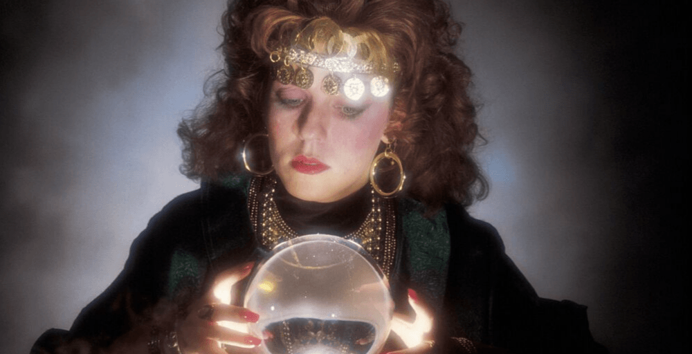 Mystic Woman Looking Into A Crystal Ball