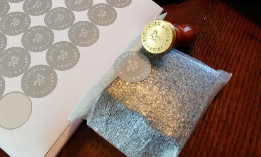 Personalised stickers and wax stamp position this jewellery brand as luxury