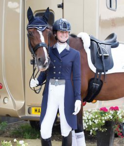 Rider smiling with horse at championships