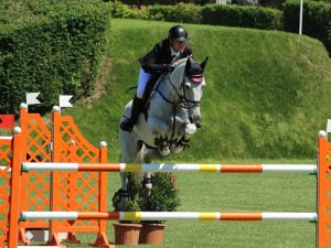 professional rider jumping horse