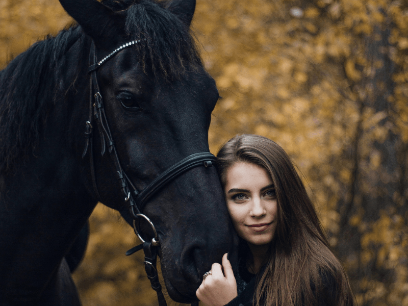 A girl hugging a black horse, an image seen often by the MirrorMePR equestrian PR team.