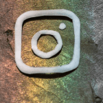 The Instagram logo on a rainbow background, selected by the MirrrorMePR social media marketing team.