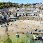 A sunny fishing port in the pretty Cornish village of Mousehole.