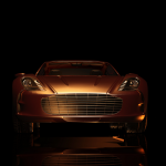 A gold Aston Martin car