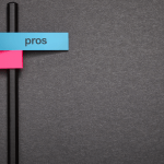 Pros and Cons pink and blue sticky notes