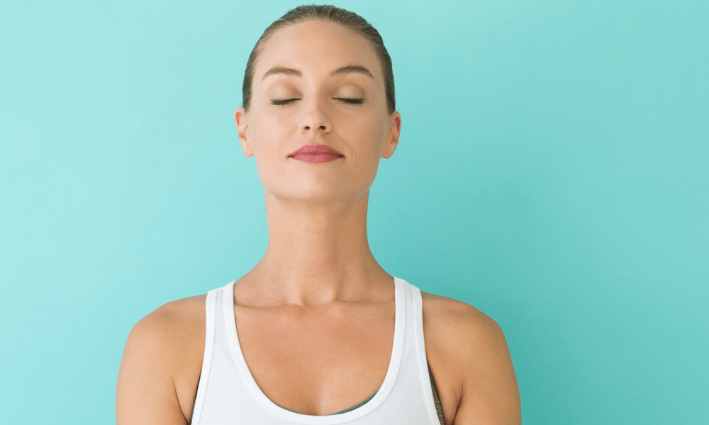 Woman using yoga breathing techniques for anxiety
