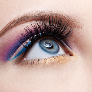 Bright swathes of coloured make-up on eyes