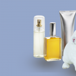 A white rabbit sitting alongside three beauty products