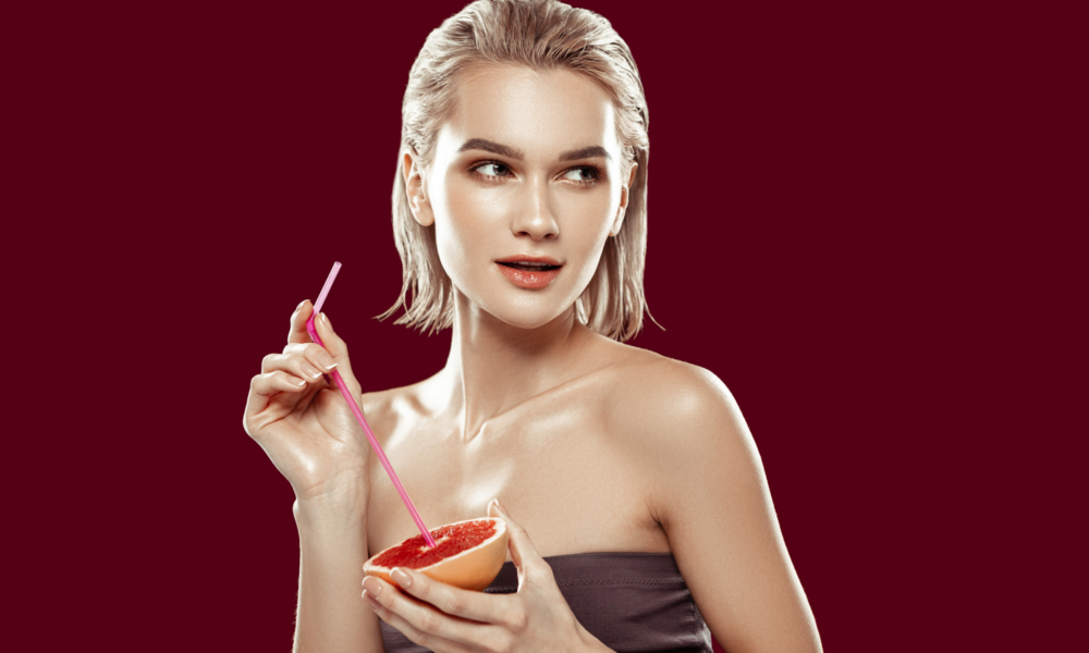Young Woman With Great Skin Holding Anti-Aging Food