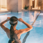 Girl in swimming pool with goggles on in one of the 6 best places to visit in the UK