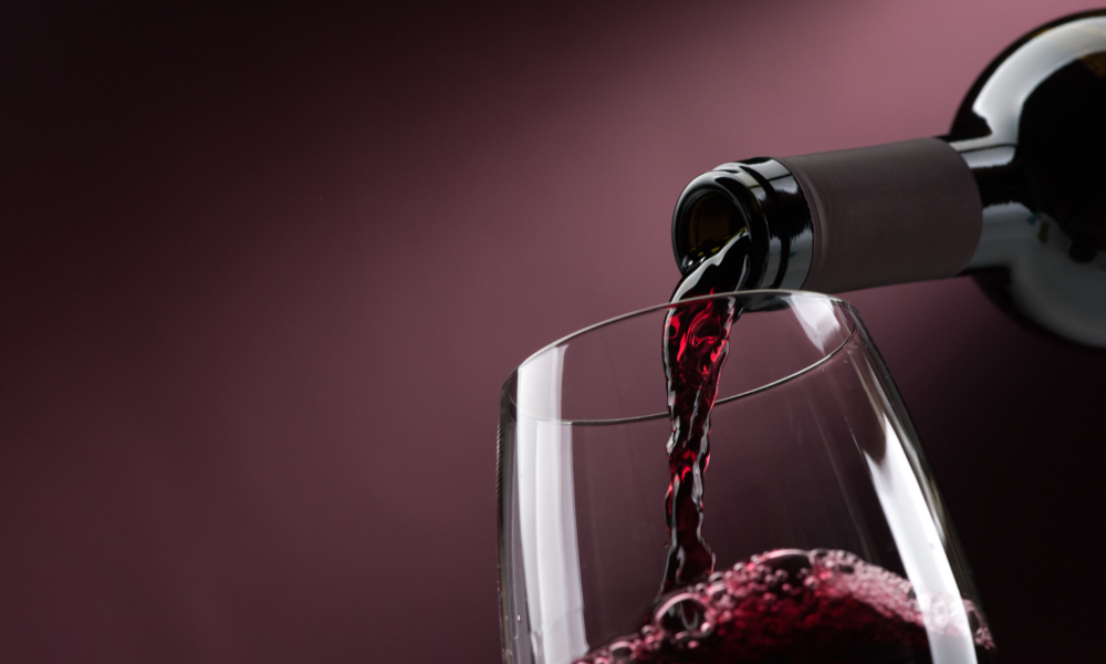 bottle of winter wine being poured into a glass