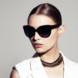 model wearing oversized sunglasses