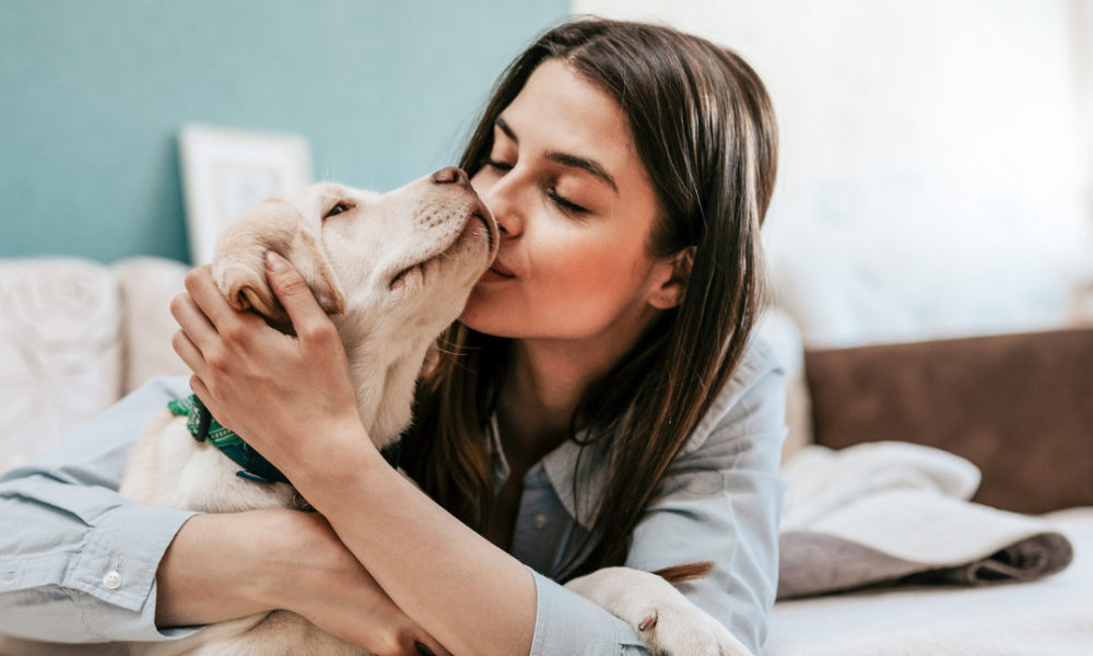 woman enjoying national pet day with her dog