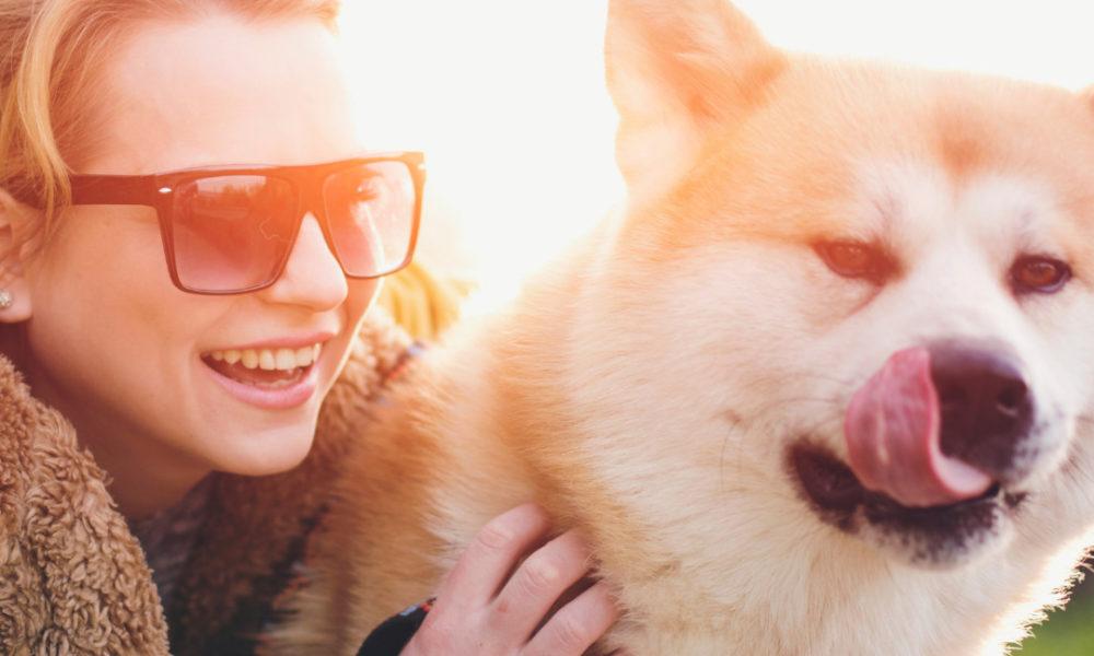 Woman enjoying hug your hound day with her dog
